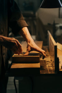 A man using one of the best woodworking square for his woodworks