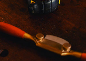 A spokeshave woodworking tool on the table