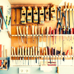 Top rated carbide woodturning tools on a wall organizer