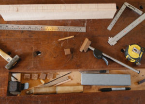 Woodworking square and tools on the table